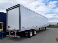 NEW GREAT DANE CHAMPION SE 48' AND 53' LOGISTIC ROLL UP DOOR TANDEM AXLE VAN TRAILERS 1